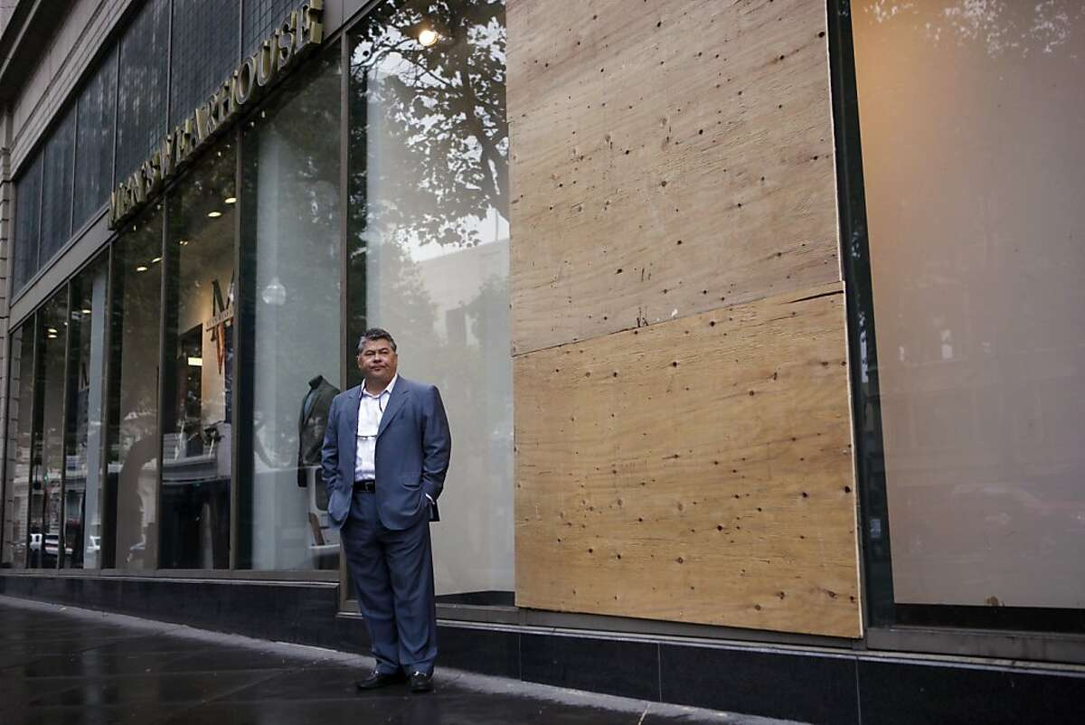 Brandishing a shotgun, Phil Tagami, manager general partner of California Capital and Investment Group, protected his company's Rotunda Building from an infiltration of vandals during Wednesday night's riots. Despite his efforts, one of the windows to Men's Warehouse was broken.