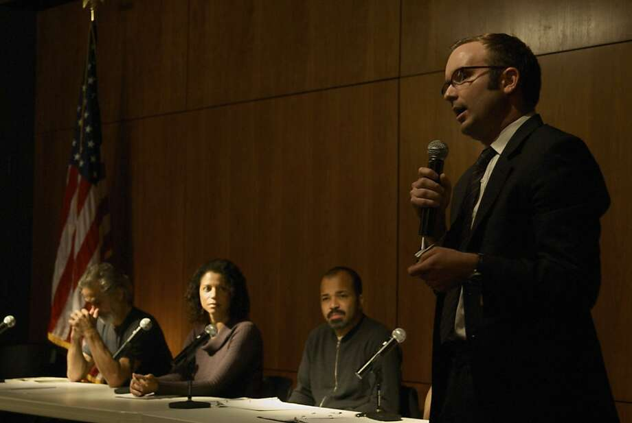 """Theater of War"" founder Bryan Doerries guides a post-reading discussion during a ""Theater of War"" event in 2009 in Manhattan. The actors for that reading included (rear, from left) David Strathairn, Gloria Reuben and Jeffrey Wright. Photo by Paxton Winters Photo: Paxton Winters"