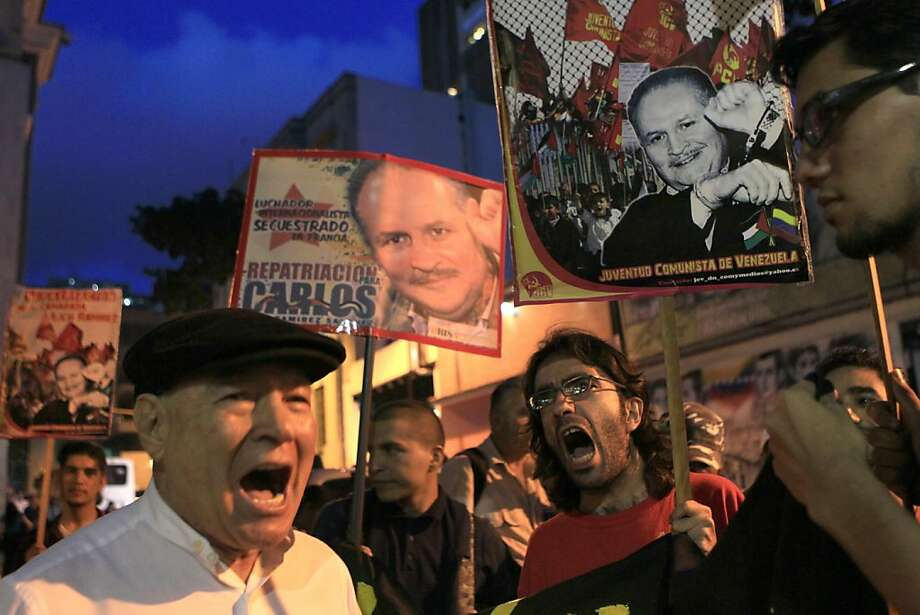 "Supporters of Ilich Ramirez Sanchez, known as ""Carlos the Jackal,"" protest demanding his repatriation in Caracas, Venezuela, Monday Nov. 7, 2011.  Ilich Ramirez went on trial Monday in France for four deadly attacks that occurred nearly three decades ago.  (AP Photo/Ariana Cubillos) Photo: Ariana Cubillos, AP"