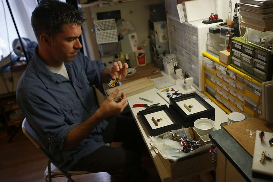 Kevin Clarke - a biologist, artist, and entrepreneur - works on an insect in his home studio in San Francisco, Calif., on Monday, Oct. 10, 2011.  Clarke uses preserved insects to create artwork and dioramas. Photo: Dylan Entelis, The Chronicle