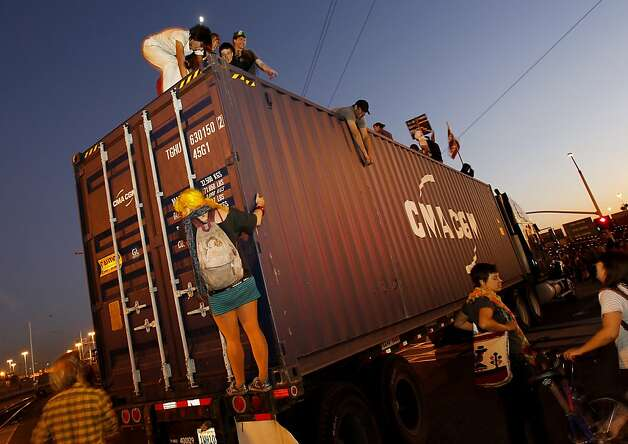 Protesters climbed trucks for a better view. Thousands of OccupyOakland supporters left their downtown protest for the Port of Oakland where they met little resistance early in the evening Wednesday November 2, 2011. They essentially shut it down by blocking entrances at the port. Photo: Brant Ward, The Chronicle