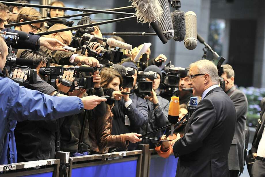 EU Commissioner for Economic and Monetary Affairs Olli Rehn  answers  the press as he arrives on November 7,2011 prior to an Eurozone meeting at the EU Headquarters in Brussels. Eurozone finance ministers regroup Monday to keep pressure on Greece to unite behind reforms in return for aid vital to its survival, and boost the firepower of a bailout fund to protect Italy. AFP PHOTO GEORGES GOBET (Photo credit should read GEORGES GOBET/AFP/Getty Images) Photo: Georges Gobet, AFP/Getty Images