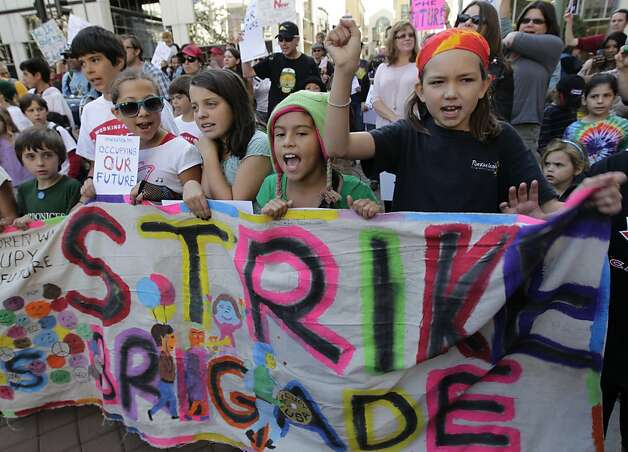 School children, including Eve Lyford (right) march with Occupy Oakland protesters during a general strike in Oakland, Calif. on Wednesday, Nov. 2, 2011. Photo: Paul Chinn, The Chronicle