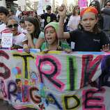 School children, including Eve Lyford (right) march with Occupy Oakland protesters during a general strike in Oakland, Calif. on Wednesday, Nov. 2, 2011.