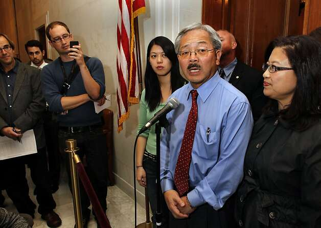 Mayor Ed Lee, with his daughter Briana, (left) and his wife Anita,  claimed victory in the Mayor's race after new numbers were released by the Department of Elections office, on Wednesday November 09, 2011, in San Francisco, Ca. Mayor Lee speaks to the media in front of the Mayor's office at City Hall. Photo: Michael Macor, The Chronicle