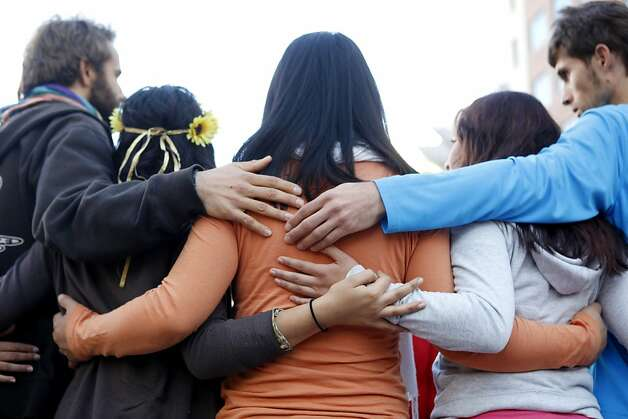 Members of liberation yoga end their morning routine with a group hug at the Occupy Oakland campsite in the morning of Wednesday, November 2, 2011 in Oakland, Calif. Photo: Beck Diefenbach, Special To The Chronicle