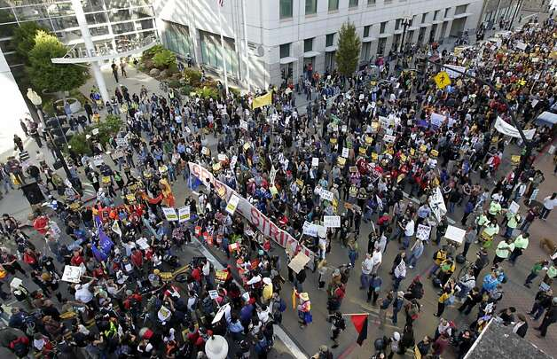 Thousands of Occupy Oakland protesters march past the Elihu Harris State Building on Clay Street during the movement's general strike in Oakland, Calif. on Wednesday, Nov. 3, 2011. Photo: Paul Chinn, The Chronicle