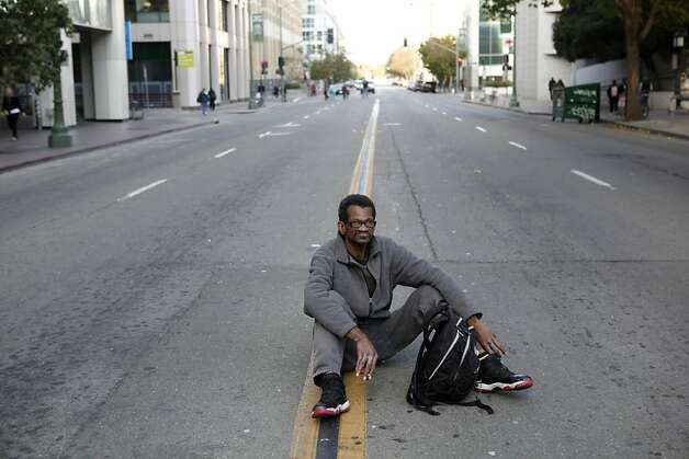 Preston Walker, of Oakland, has a cigarette while sitting in the middle of 14th Street between Clay and Broadway near the Occupy Oakland campsite in the morning of Wednesday, November 2, 2011 in Oakland, Calif. Photo: Beck Diefenbach, Special To The Chronicle