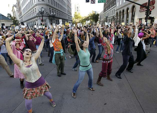 "A flash mob performs ""I Will Survive Capitalism"" at the intersection of 14th and Broadway streets during Occupy Oakland's rally and general strike in Oakland, Calif. on Wednesday, Nov. 3, 2011. Photo: Paul Chinn, The Chronicle"
