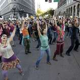"A flash mob performs ""I Will Survive Capitalism"" at the intersection of 14th and Broadway streets during Occupy Oakland's rally and general strike in Oakland, Calif. on Wednesday, Nov. 3, 2011."