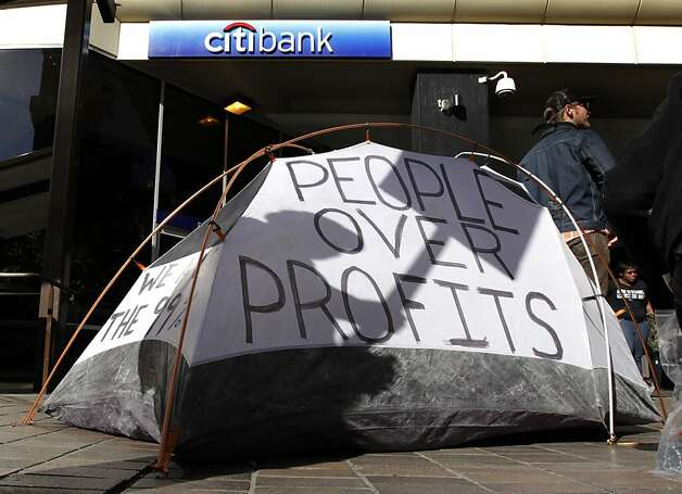 Occupy Oakland protesters pitch a tent in front of a Citibank branch at 12th and Broadway streets during a general strike in Oakland, Calif. on Wednesday, Nov. 3, 2011. Photo: Paul Chinn, The Chronicle