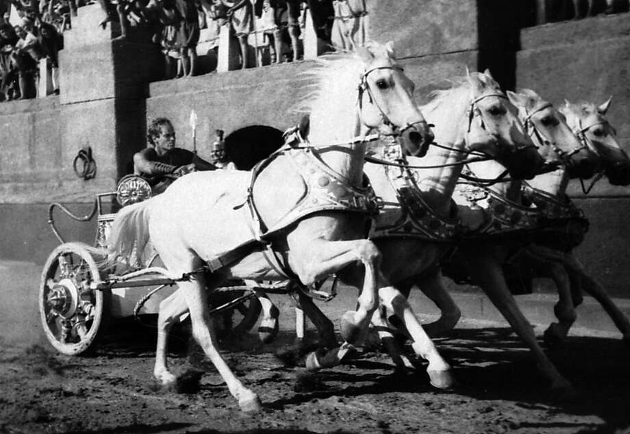 "ADVANCE FOR WEEKEND EDITIONS MARCH 8-11--FILE--Charlton Heston drives a chariot toward the finish line in a scene from the 1960 Metro-Goldwyn-Mayer classic ""Ben-Hur."" In light of the popularity for the Dreamworks' film ""Gladiator,"" nominated for 12 Academy Awards, other studios plan to release classic Roman epics such as ""Ben-Hur,"" ""Spartacus"" and ""Cleopatra"" on DVD. (AP Photo/MGM, File)  ALSO Ran on: 07-13-2004, 12/31/2004 Great scenes, clockwise from top left: Humphrey Bogart and Ingrid Bergman in &quo;Casablanca&quo; (1942), Charlie Chaplin in &quo;The Great Dictator&quo; (1940), Adrien Brody in &quo;The Pianist&quo; (2002), James Cagney in &quo;The Public Enemy&quo; (1931), Rita Hayworth in &quo;Gilda&quo; (1946), Tom Hulce and F. Murray Abraham in &quo;Amadeus&quo; (1984). Below, Charlton Heston in &quo;Ben-Hur&quo; (1960).  Ran on: 12-31-2004 Charlton Heston drives a chariot in a scene from &quo;Ben-Hur.&quo; Ran on: 12-27-2007 Charlton Heston drives a chariot toward the finish line in a scene from the 1960 movie &quo;Ben-Hur,&quo; one of the films in the Miklós Rózsa retrospective. Ran on: 05-21-2008 Cate Blanchett plays villain Irina Spalko in &quo;Indiana Jones and the Kingdom of the Crystal Skull,&quo; which relies on stuntmen and women in addition to special effects.  Ran on: 12-22-2010 Christian Bale's pick for Christmas is &quo;Ben-Hur,&quo; left, starring Charlton Heston, while Darren Aronofsky says &quo;Die Hard&quo; with Bruce Willis is his go-to holiday film. Photo: Mgm, Associated Press"