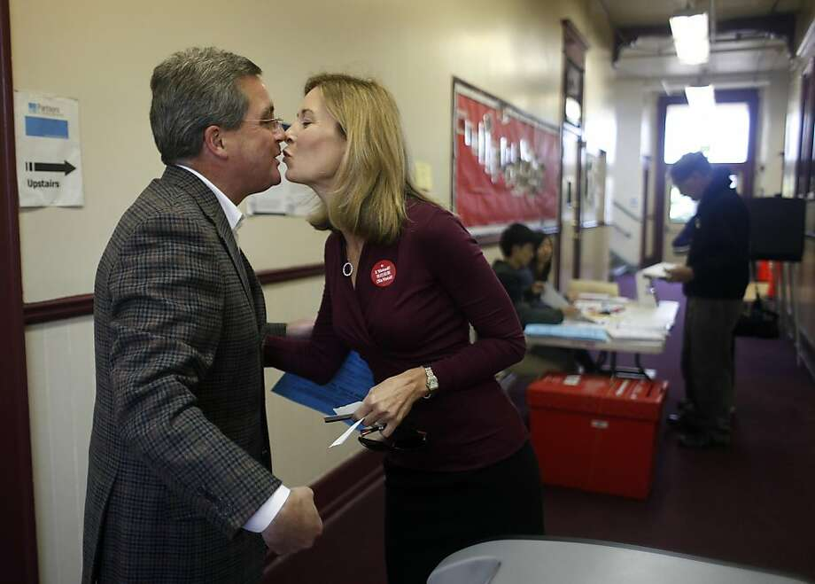 Mayoral candidate Dennis Herrera (l to r) and his wife Anne Herrera exchange a kiss after casting their votes at the Omega Boys Club on Tuesday, November 8, 2011 in San Francisco, Calif. Photo: Lea Suzuki, The Chronicle
