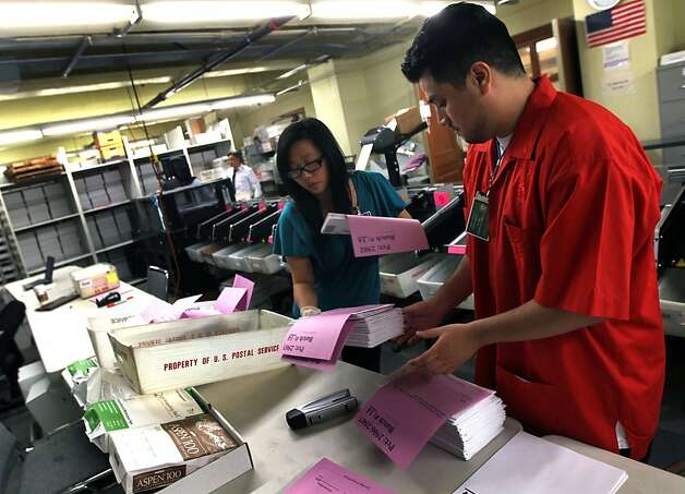 City employees Annie Xu and Elliot Bottel sort mail In ballots in the basement of San Francisco City Hall Tuesday November 8, 2011 Photo: Lance Iversen, The Chronicle
