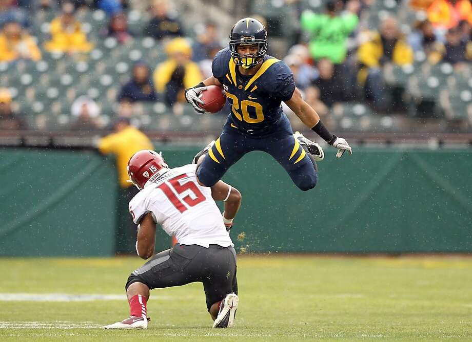 SAN FRANCISCO, CA - NOVEMBER 05:  Isi Sofele #20 of the California Golden Bears jumps over Tyree Toomer #15 of the Washington State Cougars at AT&T Park on November 5, 2011 in San Francisco, California.  (Photo by Ezra Shaw/Getty Images) Photo: Ezra Shaw, Getty Images