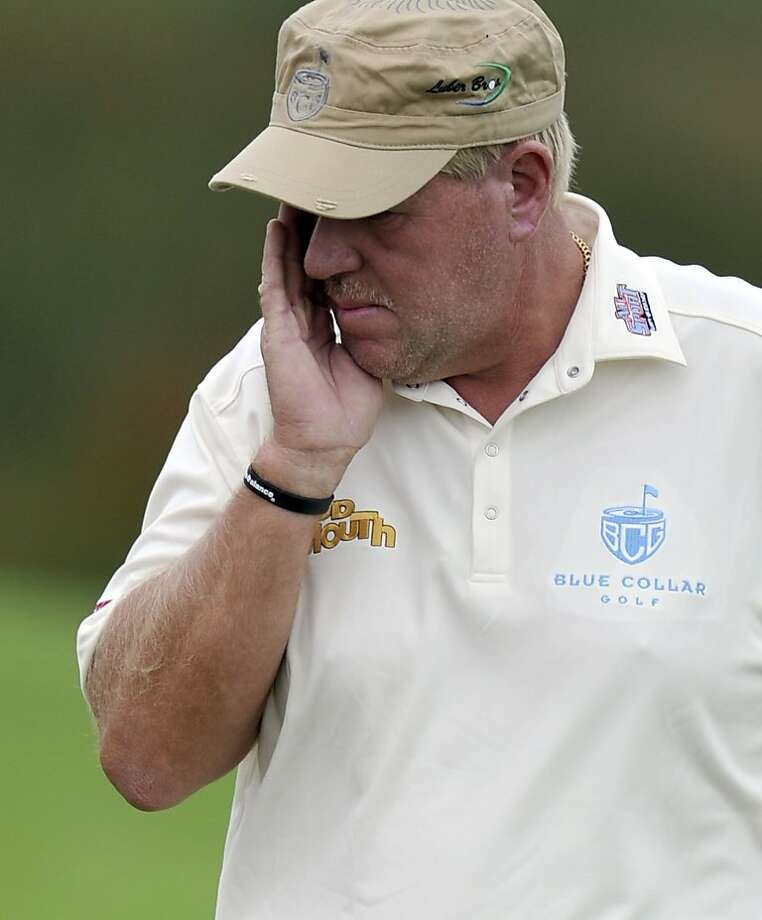 US golfer John Daly reacts after missing a fairway shot on the 1st hole during the first round of the Australian Open golf tournament in Sydney, Australia, Thursday, Nov. 10, 2011. Daly walked off the course at the Australian Open on Thursday after hitting at least five or six balls _ officials aren't sure of the number _ into the water on the 11th hole at The Lakes. (AP Photo/Rob Griffith) Photo: Rob Griffith, AP