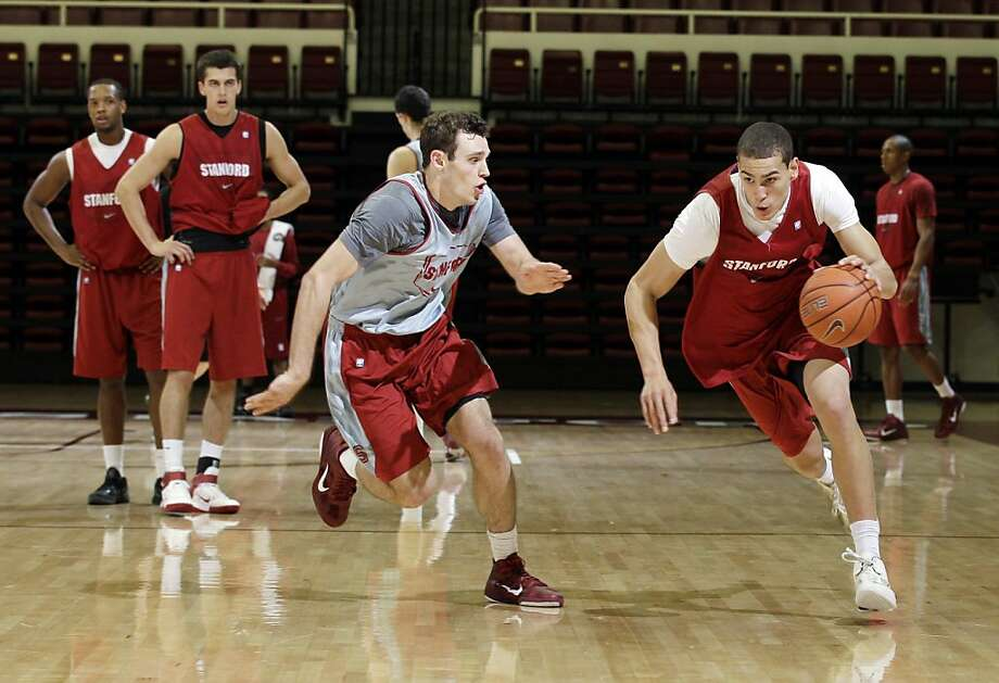 In this photo taken Oct. 25, 2011, Stanford's Dwight Powell, right, dribbles as teammate Robbie Lemons defends during their NCAA basketball practice in Stanford, Calif. Stanford finished 15-16 last season and 7-11 in conference play, good for seventh in the league. If Stanford hopes to break away from the middle of the pack, it will have to make strides with many of the same players.  (AP Photo/Marcio Jose Sanchez) Ran on: 11-09-2011 Dwight Powell, a returning starter for Stanford, needs to provide more scoring. Photo: Marcio Jose Sanchez, AP