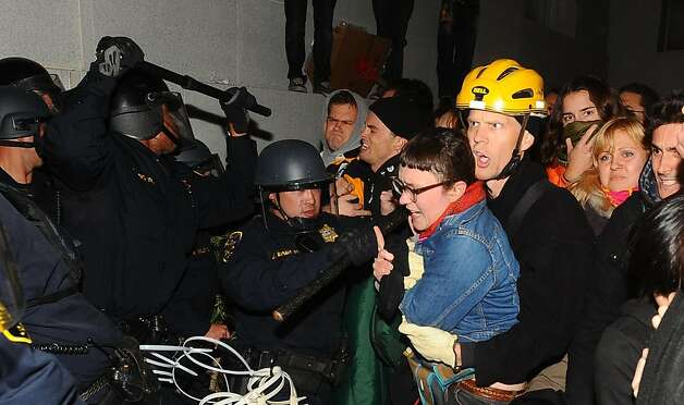 Police remove protesters occupying UC Berkeley on Wednesday, Nov. 9, 2011, in Berkeley, Calif. Ran on: 11-11-2011 Police removed protesters trying to occupy UC Berkeley on Wednesday, enforcing the campus' no-encampment policy. Ran on: 11-11-2011 Police removed protesters trying to occupy UC Berkeley on Wednesday, enforcing the campus' no-encampment policy. Photo: Noah Berger, Special To The Chronicle