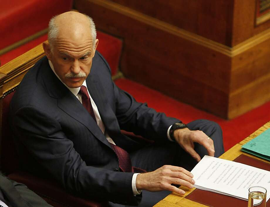Greek Prime Minister George Papandreou attends a parliament meeting in Athens, on Friday, Nov. 4, 2011.  Greece's ruling Socialists were in open revolt against their own prime minister ahead of a confidence vote Friday, in a political free-for-all over a new European plan to keep the deeply indebted country afloat. (AP Photo/Thanassis Stavrakis)  Ran on: 11-07-2011 George Papandreou's offer to resign was forced by his own Socialists. Photo: Thanassis Stavrakis, AP