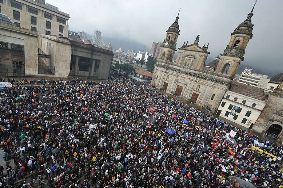 Students take part in a demonstration against an education reform bill at Bogota's main square Plaza de Bolivar, on November 10, 2011. Thousands of students from more than 30 public universities took to the streets in Colombia to protest against proposed education reforms they fear will partially privatize higher education. The students have been on strike over the past month to protest a bill put forward by President Juan Manuel Santos that would require public universities to generate some of their own revenues. On Wednesday Santos offered to withdraw the draft and open a dialogue if the more than half a million students on strike lift their form of pressure. AFP PHOTO/Guillermo Legaria (Photo credit should read GUILLERMO LEGARIA/AFP/Getty Images) Photo: Guillermo Legaria, AFP/Getty Images