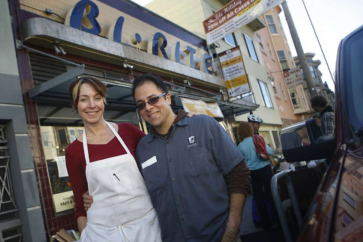 Bi-Rite Market owners Anne Walker (l to r) and Sam Mogannam are seen in front of Bi-Rite Market in San Francisco, Calif. on Monday November 23, 2009. Ran on: 11-26-2009 Owners Anne Walker and Sam Mogannam stand in front of Bi-Rite Market on 18th Street in San Francisco.