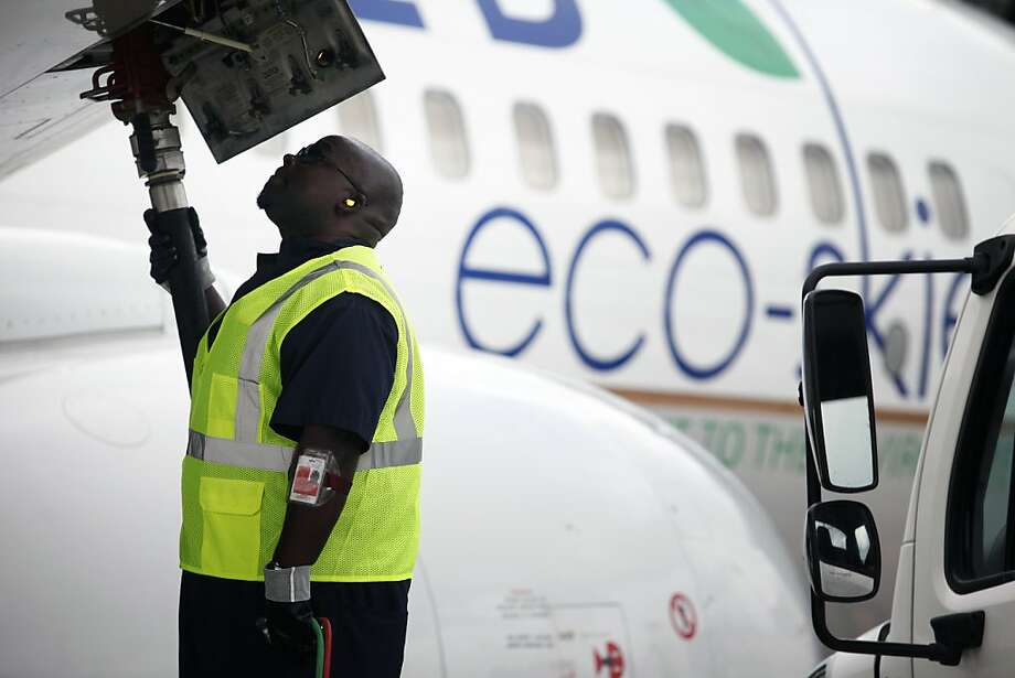 Monte Hawkins, lead aircraft refueler, fills the taxi'd aircraft with biofuel, prior to the first US commercial flight powered by advanced biofuel, Monday, November 7, 2011 at George Bush Intercontinental Airport in Houston, Texas. The Boeing 737 departed terminal E at 10:30am and was bound for Chicago O'Hare International Airport. (Todd Spoth / For The Chronicle) Photo: Todd Spoth, For The Chronicle