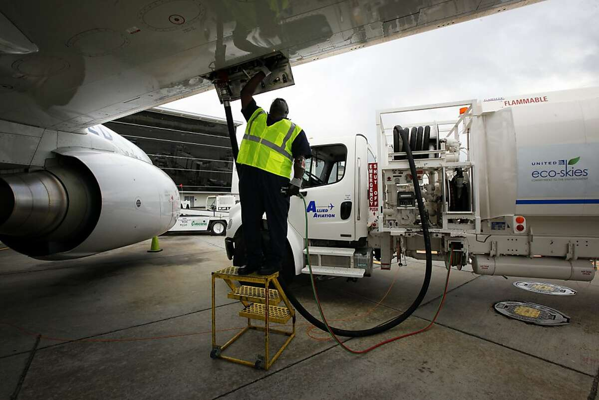 Monte Hawkins, lead aircraft refueler, fills the taxi'd aircraft with biofuel, prior to the first US commercial flight powered by advanced biofuel, Monday, November 7, 2011 at George Bush Intercontinental Airport in Houston, Texas. The Boeing 737 departed terminal E at 10:30am and was bound for Chicago O'Hare International Airport. (Todd Spoth / For The Chronicle)
