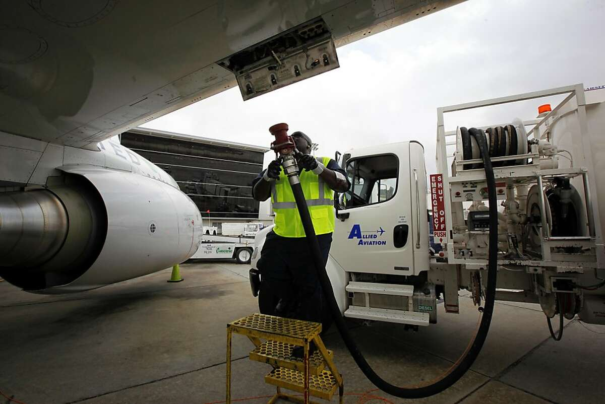 Monte Hawkins, lead aircraft refueler, prepares to fill the taxi'd aircraft with biofuel, prior to the first US commercial flight powered by advanced biofuel, Monday, November 7, 2011 at George Bush Intercontinental Airport in Houston, Texas. The Boeing 737 departed terminal E at 10:30am and was bound for Chicago O'Hare International Airport. (Todd Spoth / For The Chronicle)