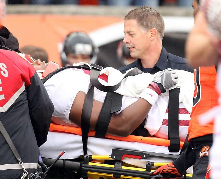 Stanford receiver Chris Owusu is taken to an ambulance after he was injured on a reception during the first half of their NCAA college football game against Oregon State, Saturday, Nov. 5, 2011, in Corvallis, Ore. (AP Photo/Don Ryan)   Ran on: 11-07-2011 Chris Owusu was carted off the field Saturday at Oregon State. Ran on: 11-07-2011 Chris Owusu was carted off the field Saturday at Oregon State. Photo: Don Ryan, AP