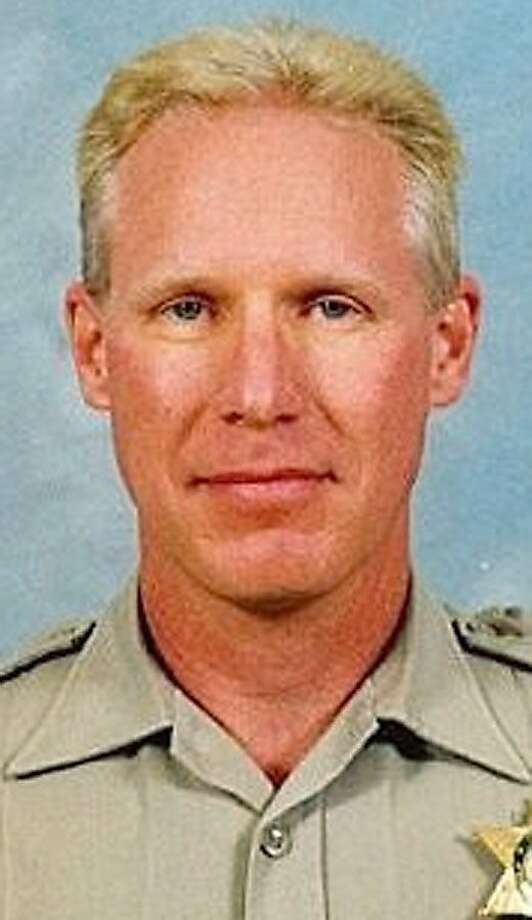 In this undated handout photo provided by the Fresno County Sheriff's Office, Deputy Joel Wahlenmaier is shown. Wahlenmaier, 49, was shot and killed as he was trying to serve a search warrant on Thursday, Feb. 25, 2010 in Minkler, Calif. Deputy Mark Harris was wounded and is recovering. Officer Javier Bejar, who was patrolling in the nearby town of Reedley, also was critically wounded when he arrived for backup.    (AP Photo/Fresno County Sheriff's Office, handout)  Ran on: 02-27-2010 Photo caption Dummy text goes here. Dummy text goes here. Dummy text goes here. Dummy text goes here. Dummy text goes here. Dummy text goes here. Dummy text goes here. Dummy text goes here.###Photo: fresno27_ph_wahlenmaier1267056000Fresno County Sheriff's Office###Live Caption:In this undated handout photo provided by the Fresno County Sheriff?s Office, Deputy Joel Wahlenmaier is shown. Wahlenmaier, 49, was shot and killed as he was trying to serve a search warrant on Thursday, Feb. 25, 2010 in Minkler, Calif. Deputy Mark Harris was wounded and is recovering. Officer Javier Bejar, who was patrolling in the nearby town of Reedley, also was critically wounded when he arrived for backup.###Caption History:In this undated handout photo provided by the Fresno County Sheriff  Ran on: 11-10-2011 Joel Wahlenmaier was killed trying to serve a search warrant. Photo: AP