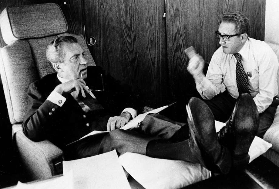 FILE - In this June 25, 1974, photo released by the White House, President Richard Nixon listens to his Secretary of State Dr. Henry Kissinger aboard the plane that brought the U.S. president to Belgium. Within two months Nixon had resigned, and in June 1975, the feisty ex-President defended his shredded legacy and shady Watergate-era actions in grand jury testimony that he thought would never come out. On Thursday, Nov. 10, 2011, it did. (AP Photo/White House Photo, Ollie Akins) Photo: Ollie Akins, AP
