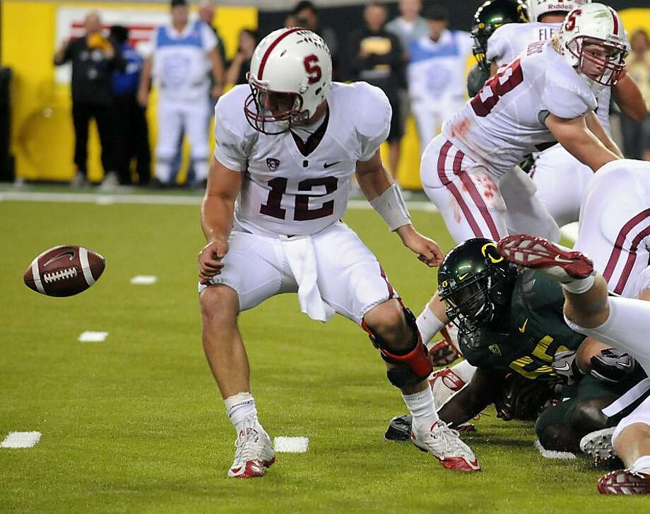 EUGENE, OR - OCTOBER 2: Quarterback Andrew Luck of the Stanford Cardinal can't find the ball as he fumbles it near the goal line in the fourth quarter of the game against the the Oregon Ducks at Autzen Stadium on October 2, 2010 in Eugene, Oregon. Oregon won the game 52-31. (Photo by Steve Dykes/Getty Images)  Ran on: 10-04-2010 Stanford and quarterback Andrew Luck let the game get away from them against Oregon, and any consolation probably does not involve the Rose Bowl. Photo: Steve Dykes, Getty Images