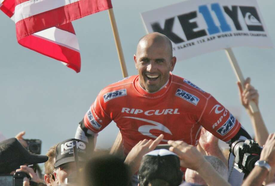 Kelly Slater is carried to the podium after winning his 11th Association of Surfing Professionals World Championship on Wednesday, Nov. 2, 2011, in San Francisco, Calif. Photo: Mathew Sumner, Special To The Chronicle