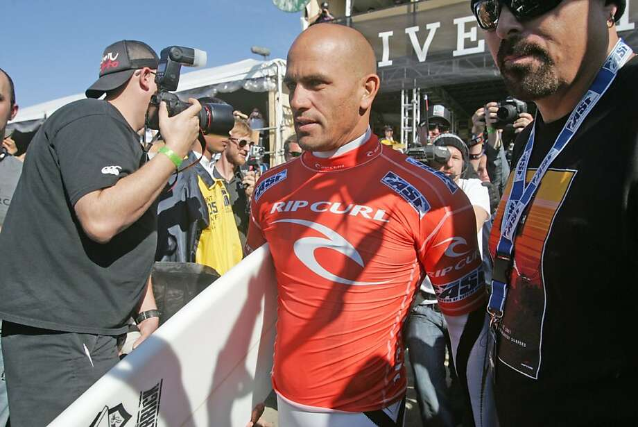 Kelly Slater walks to the water at Ocean Beach during the Rip Curl Pro Search surf contest on Wednesday, Nov. 2, 2011, in San Francisco, Calif. Photo: Mathew Sumner, Special To The Chronicle