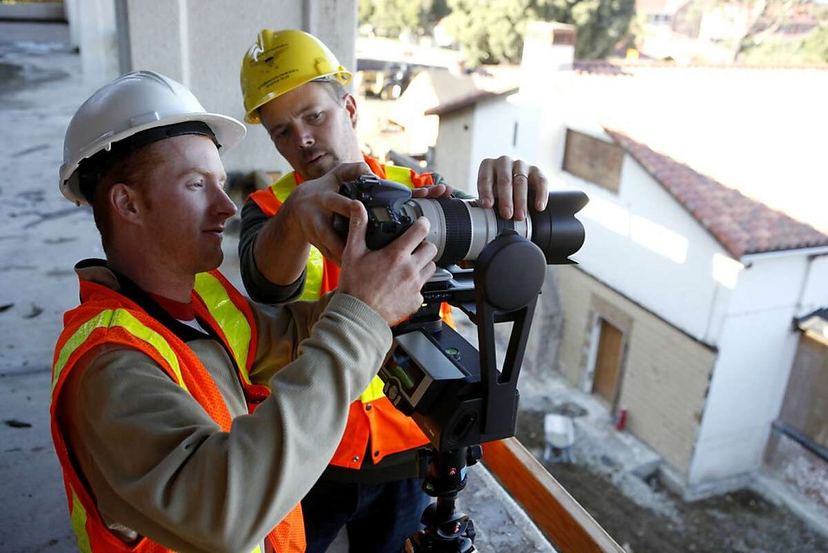 Center of Digital Archeology workers Connor Rowe (left) and Michael Ashley adjust the camera settings on a Gigapan mount to make a panoramic image of the renovation of the Officer's Club in the Presidio on Tuesday, November 8, 2011 in San Francisco, Calif.
