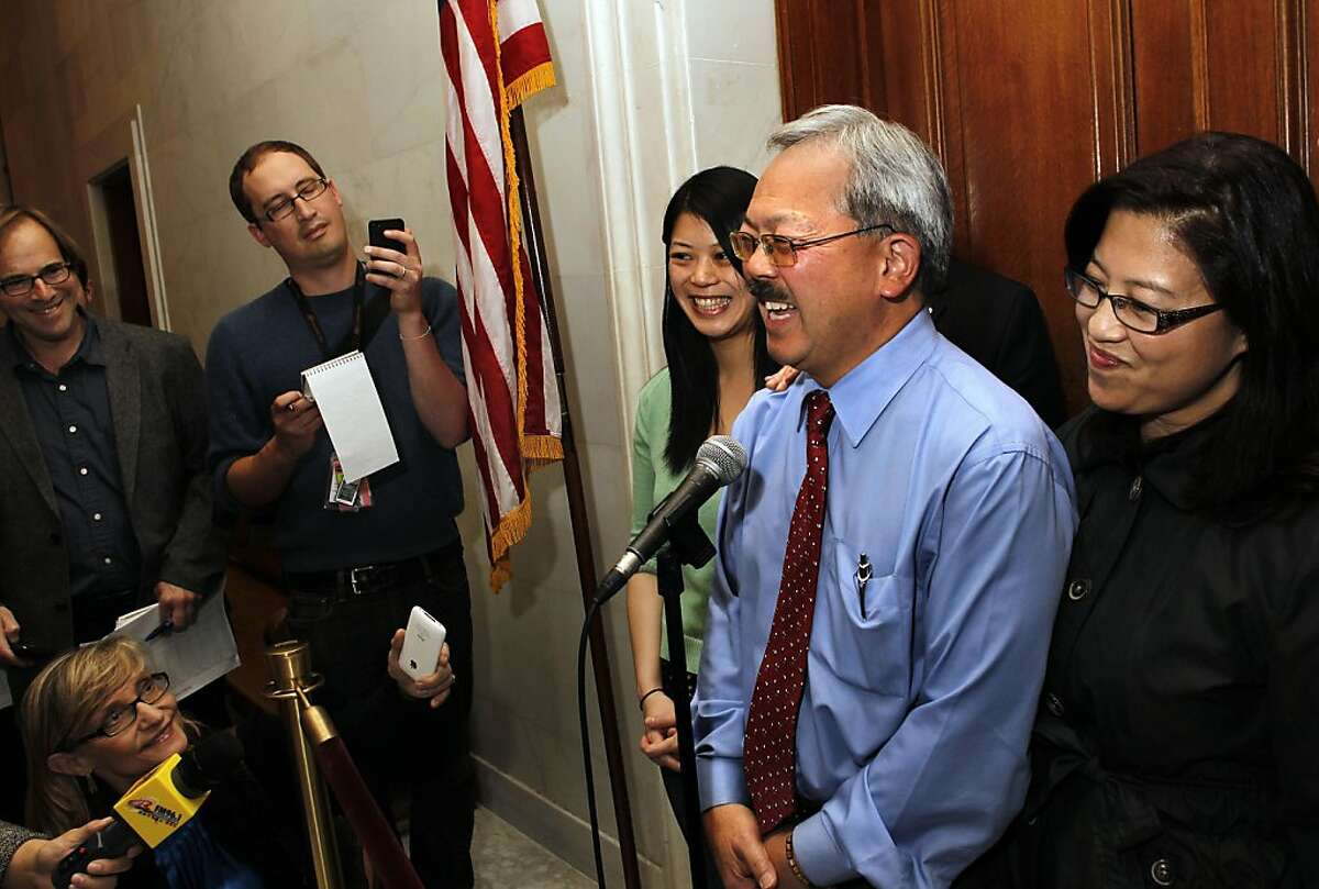 Mayor Ed Lee, with his daughter Briana, (left) and his wife Anita, claimed victory in the Mayor's race after new numbers were released by the Department of Elections office, on Wednesday November 09, 2011, in San Francisco, Ca. Mayor Lee speaks to the media in front of the Mayor's office at City Hall.