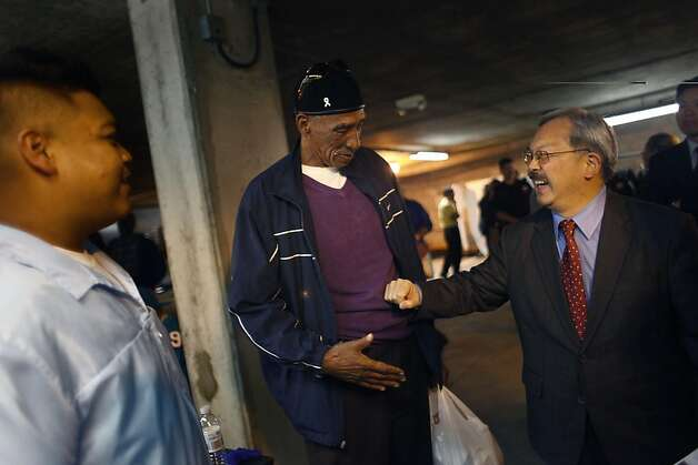 Mayor Ed Lee (right) talks with veteran Clifford Curry(center) who introduced Lee to barber student and volunteer Victor Salvador (right) as Lee visits Vet Connect which was held at the San Francisco Veterans Affairs Downtown Clinic/Comprehensive Homeless Center on Wednesday, November 11, 2011 in San Francisco, Calif. Photo: Lea Suzuki, The Chronicle