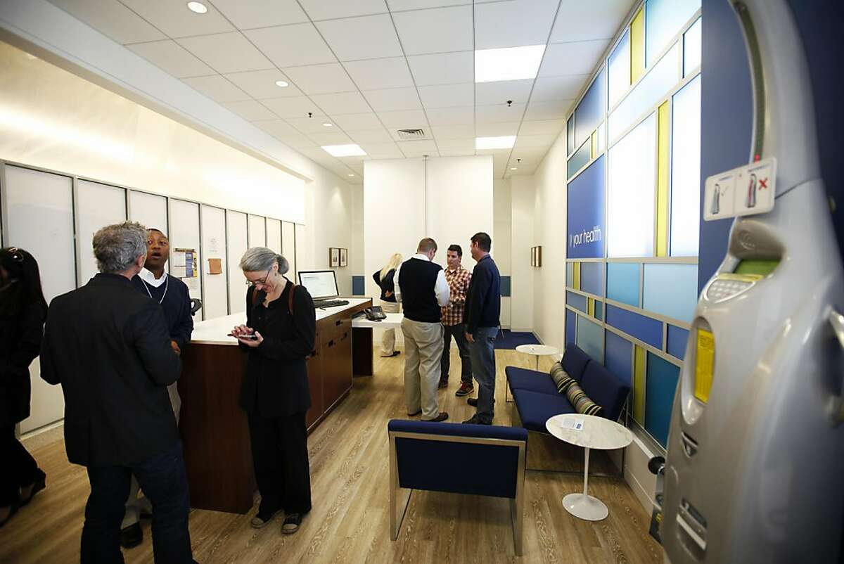 Blue Shield employees and guests attend the pre-opening of the health insurer's first retail store in California and the first ever in a grocery store in the country located in Lucky Supermarket at 1750 Fulton Street in San Francisco, Calif. on Friday Nov. 4, 2011.