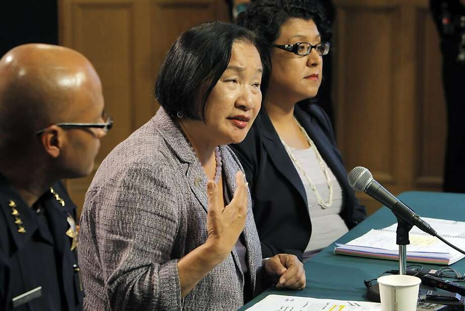 Oakland Mayor Jean Quan, center, answers a question during a press conference at City Hall in Oakland, Calif, on Wednesday, October 26, 2011. Quan, interim Police Chief Howard Jordan, left, and City Administrator Deanna Santana, off camera, anwered questions, Wednesday, after police used tear gas and non-lethal weapons against demonstrators from the Occupy Oakland group the previous night. Photo: Carlos Avila Gonzalez, The Chronicle