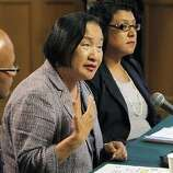 Oakland Mayor Jean Quan, center, answers a question during a press conference at City Hall in Oakland, Calif, on Wednesday, October 26, 2011. Quan, interim Police Chief Howard Jordan, left, and City Administrator Deanna Santana, off camera, anwered questions, Wednesday, after police used tear gas and non-lethal weapons against demonstrators from the Occupy Oakland group the previous night.