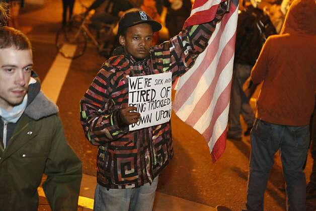 An Occupy Oakland protestor stops to survey the scene and display his sign, near 19th St. and Telegraph Avenue in Oakland, Calif., on Wednesday, Oct. 27, 2011. Photo: Dylan Entelis, The Chronicle