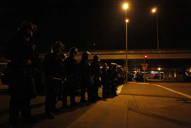 During a late night march, police cordoned off streets and steered Occupy Oakland protestors back to City Hall in Oakland, Calif., on Wednesday, Oct. 27, 2011. Photo: Dylan Entelis, The Chronicle