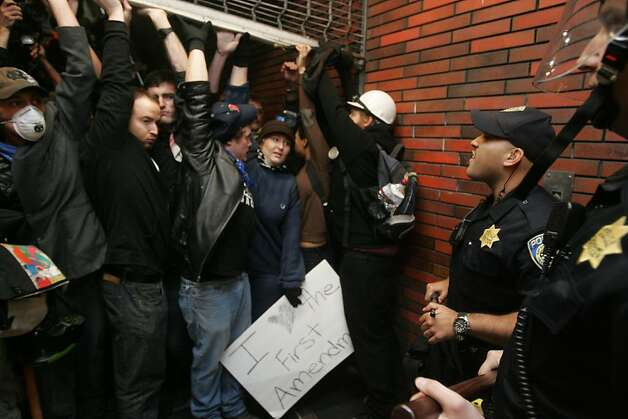 Occupy Oakland protesters hold up a roll up door at a BART station after BART Police closed the barricade to prevent the rush of  protesters from getting on the system on Wednesday, Oct. 26, 2011, in Oakland, Calif. Photo: Mathew Sumner, Special To The Chronicle