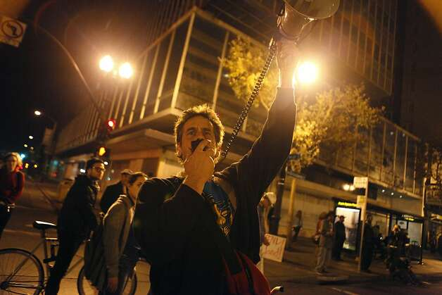 Matthew Puffer relays messages to Occupy Oakland protestors using a bullhorn at 14th St. and Broadway, near Frank Ogawa Plaza in Oakland, Calif., on Wednesday, Oct. 27, 2011.  More than 3,000 protestors conducted a late night march on Wednesday. Photo: Dylan Entelis, The Chronicle
