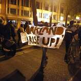Occupy Oakland protestors march near 16th St. and Telegraph Avenue in Oakland, Calif., on Wednesday, Oct. 27, 2011.