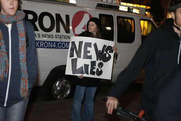 An Occupy Oakland protestor addresses the news media with a sign,  at Frank Ogawa Plaza in front of City Hall in Oakland, Calif., on Wednesday, Oct. 27, 2011. Photo: Dylan Entelis, The Chronicle