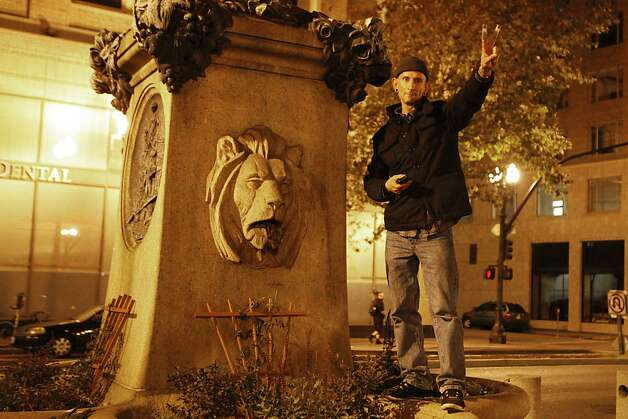 An Occupy Oakland protestor who declined to be identified holds up the peace sign during a late night march in Oakland, Calif., on Wednesday, Oct. 27, 2011. Photo: Dylan Entelis, The Chronicle