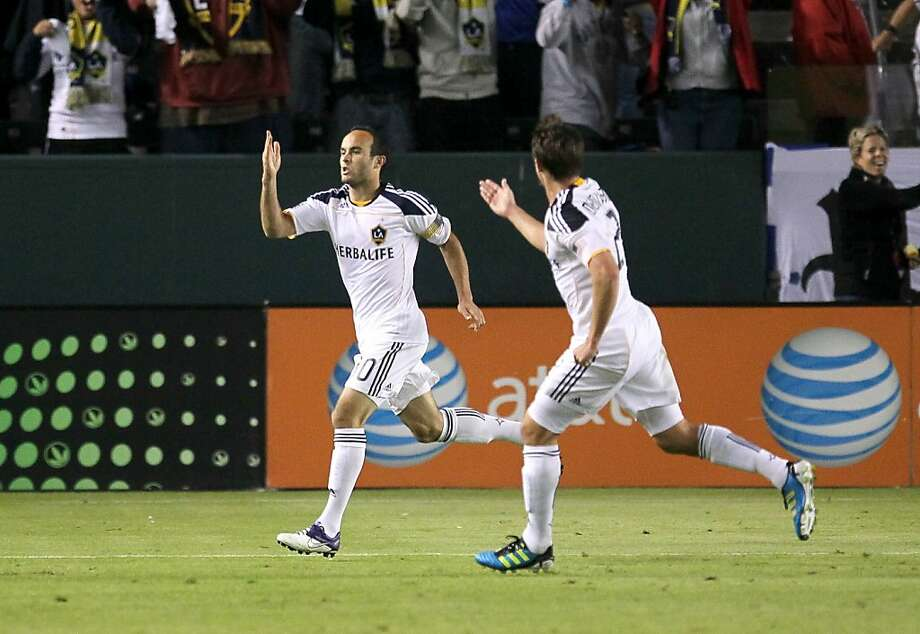 CARSON, CA - NOVEMBER 06:  Landon Donovan #10 of the Los Angeles Galaxy celebrates with Todd Dunivant #2 after scoring on a penalty kick in the first half against Real Salt Lake in the MLS Western Conference Championship at The Home Depot Center on November 6, 2011 in Carson, California.  (Photo by Stephen Dunn/Getty Images) Photo: Stephen Dunn, Getty Images
