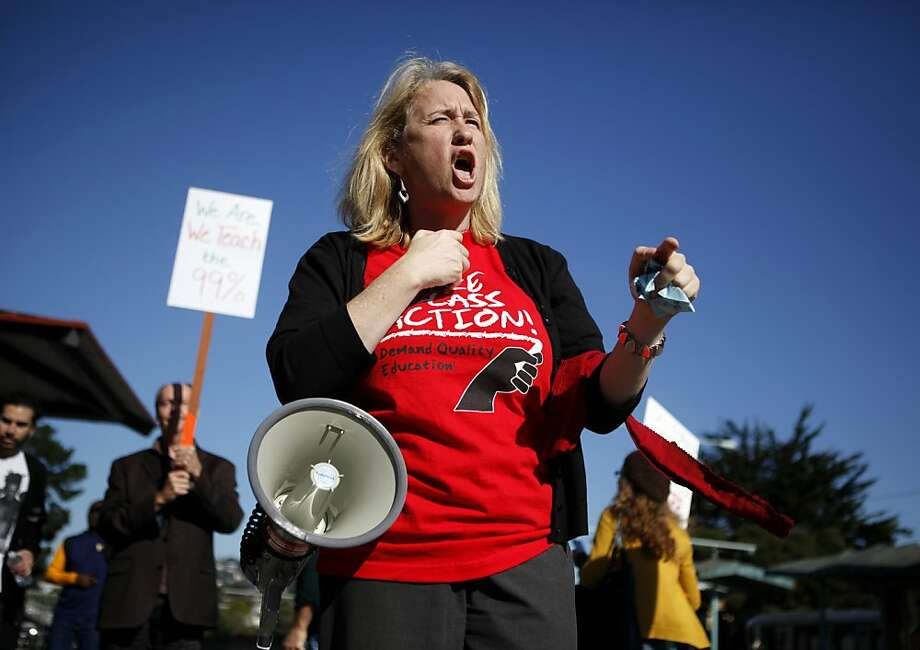 San Francisco State University faculty member Catherine Powell leads chants during a protest against cuts to public education at San Francisco State University on Tuesday, November 11, 2011 in San Francisco, Calif. Photo: Beck Diefenbach, Special To The Chronicle