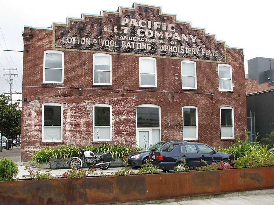 The former Pacific Felt Factory was converted into lofts in 1998, but the careful restoration of brickwork and signage has retained the cultural presence of the former use. Photo: John King